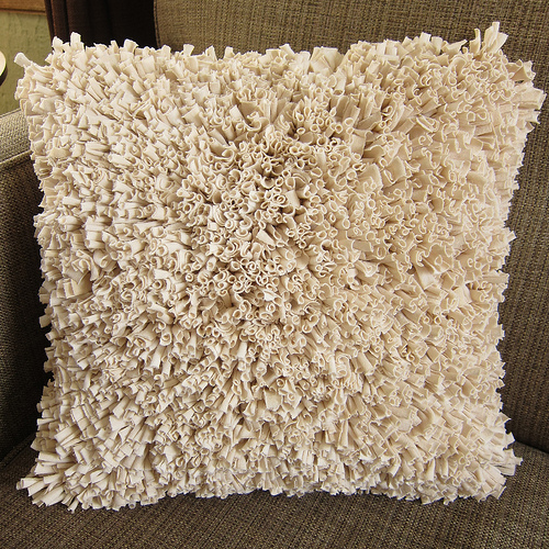 almohadon-flecos