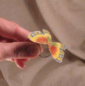 Anillo de mariposa de tela en 3D